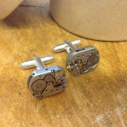 Close up image of Lilly Dilly's bespoke cufflinks made out of watch parts
