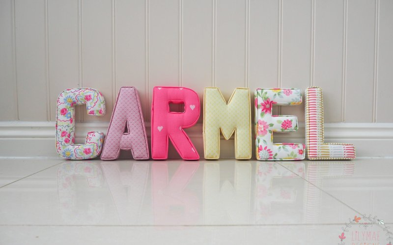 different nursery ideas bright pinks and yellows and pale pink fabrics studio g Clarke and clarke girls fabric padded wall letters