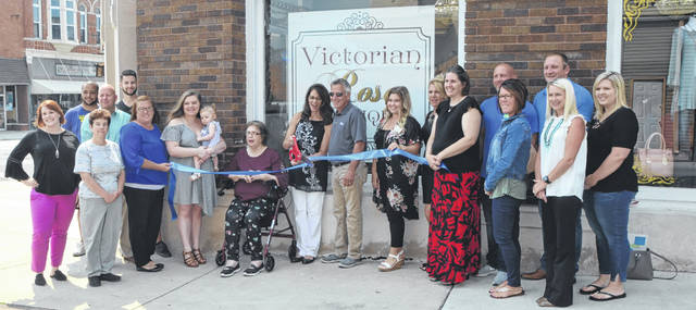 Victorian Rose Boutique Owner Vicky Kayser Cuts The Ribbon At A Ceremony With Family And Delphos