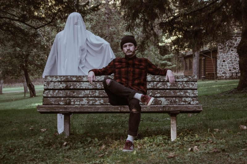Man on bench with ghost