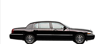 4 passenger black executive sedan photo
