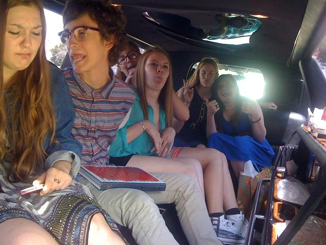 Having fun riding in their Orange County Limousine