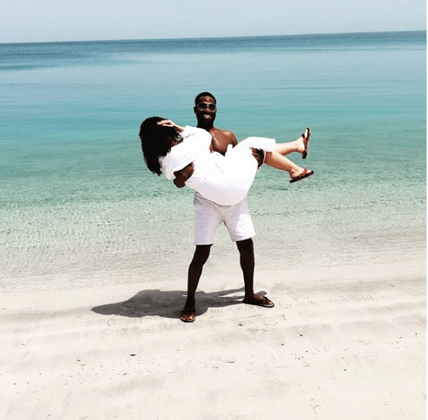 Loved-up photo of Dbanj carrying his wife as they pose at a beach in Dubai