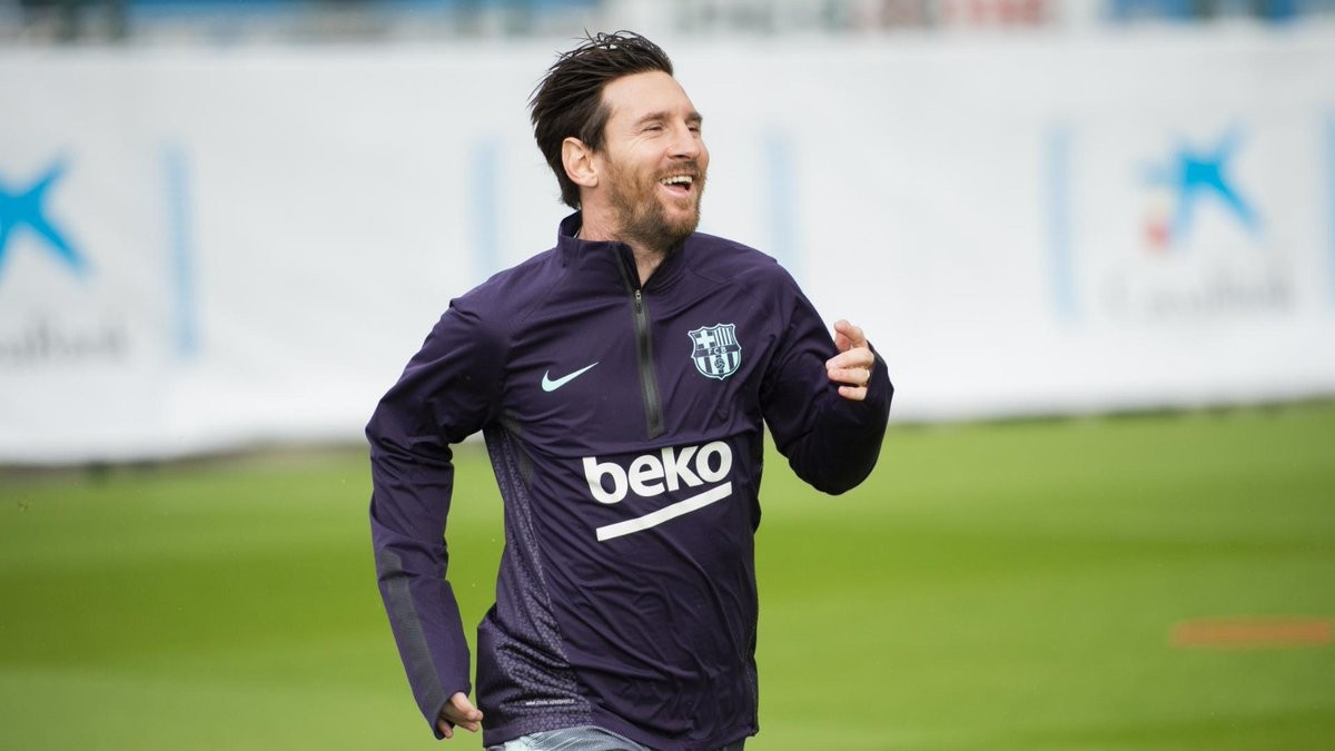 Lionel Messi all smiles as he returns to full training after breaking his arm