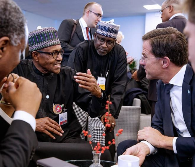 Caption this photo of President Buhari and thePrime Minister of Netherlands,Mark Rutte in Poland