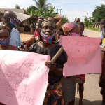Women protest half-naked, beg Governor Wike to release manager of demolished hotel who allegedly tested positive for Coronavirus (photos)