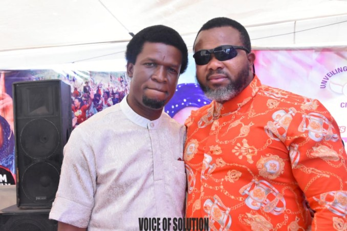 Prophetess Rose supports a pastor and a soldier with cash at Unveiling City Abuja lindaikejisblog3