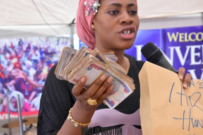 Prophetess Rose supports a pastor and a soldier with cash at Unveiling City Abuja lindaikejisblog7