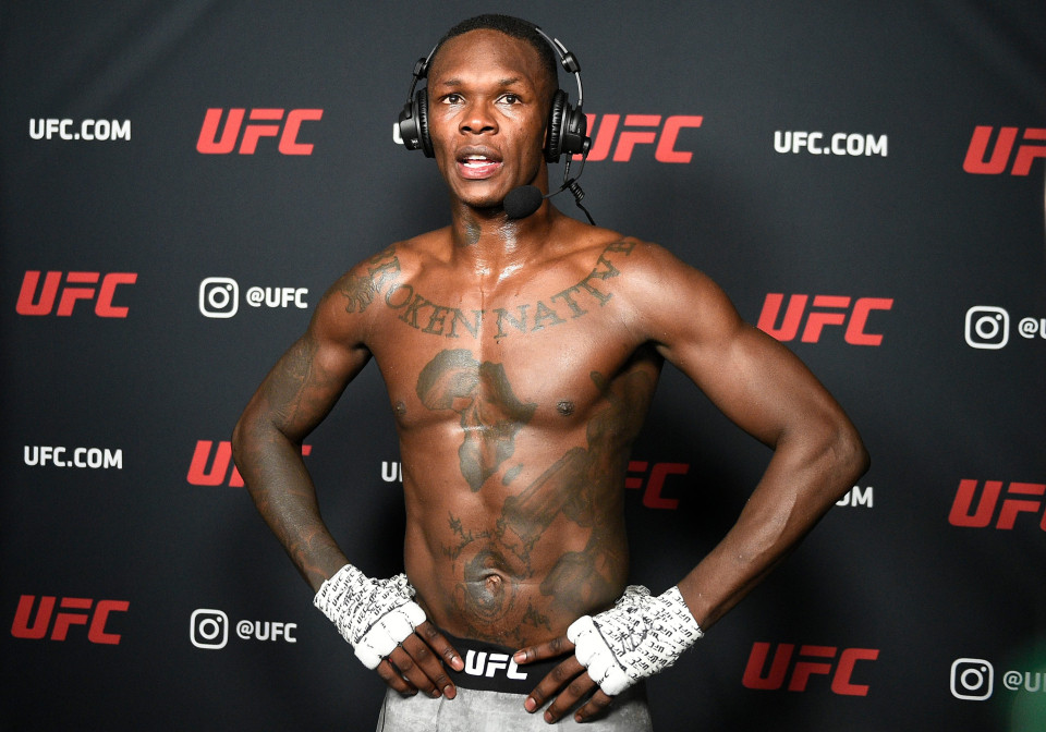 Israel Adesanya dropped by BMW after rape comments to rival Kevin Holland