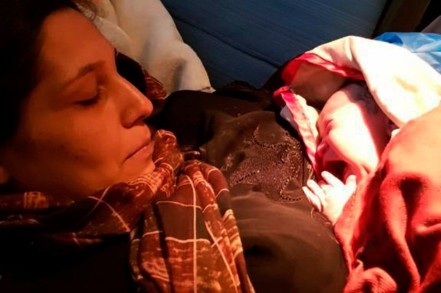 Woman fleeing Afghanistan gives birth on flight to UK 2