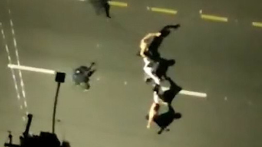 Hostages used as human shields on top of cars in Brazil bank robbery 1