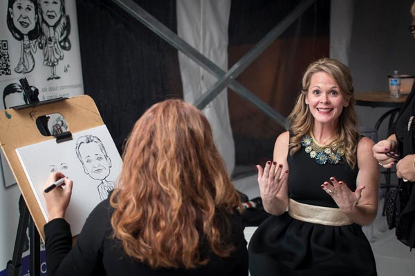 Caricature artist drawing at swanky wedding