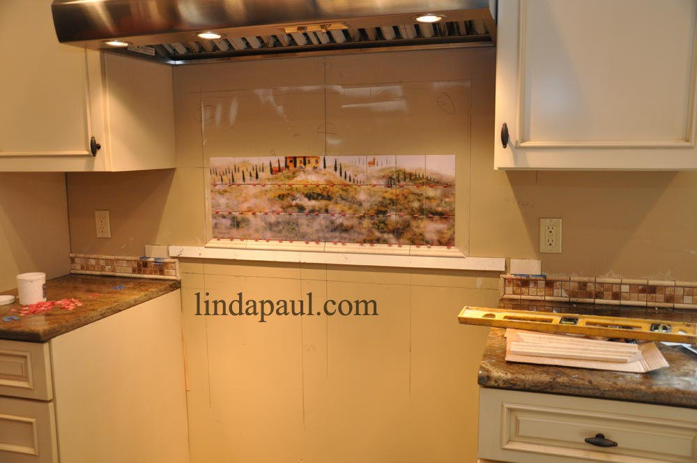 mural and medallion kitchen backsplash
