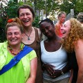 four diverse women laughing together
