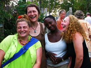 four diverse women laughing together, stress-buster