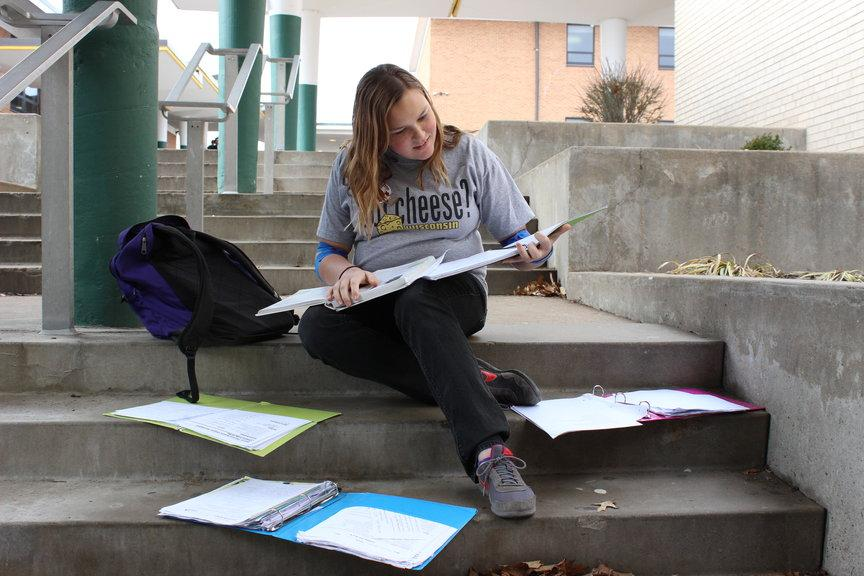 Amanda Aiken (10)  anxiously  checks her homework before class.