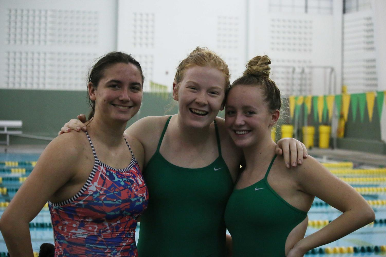 Jennie Weaver (11), Natalie Evans (11) and Samantha Hurst (12) after completing their events.