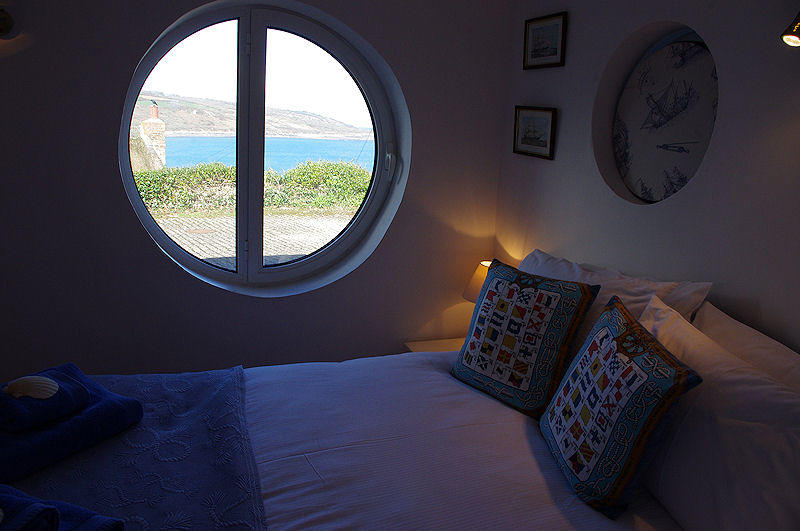 Boak Cottage - Port Hole view from the bedroom - self catering Cornwall