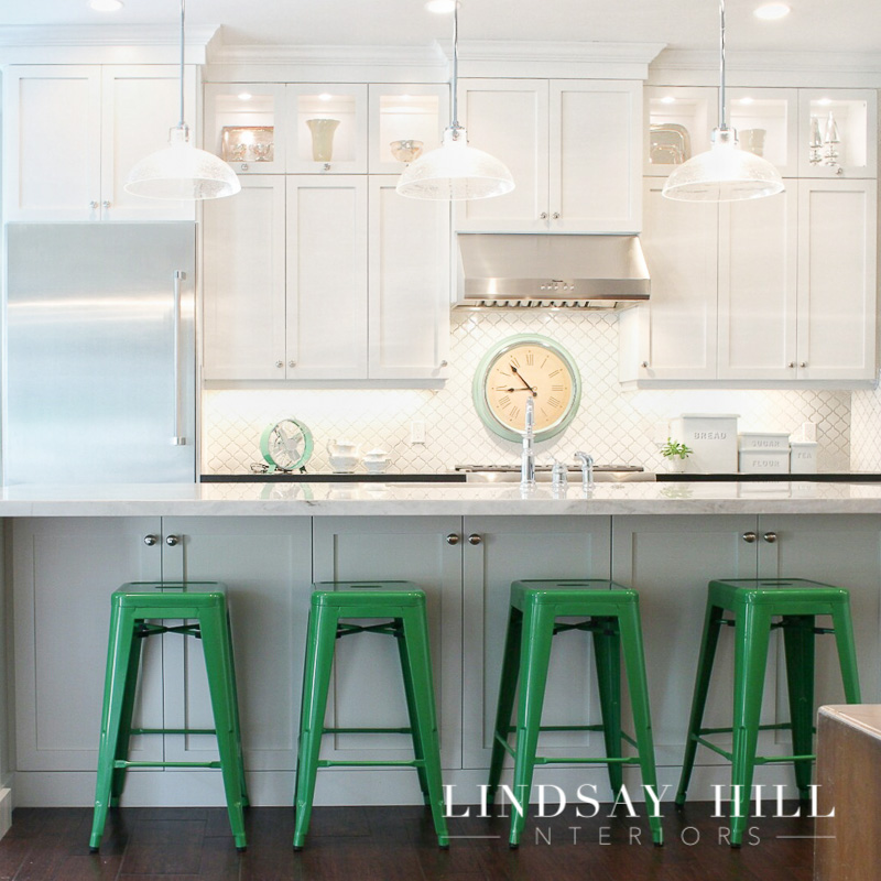 white kitchen with green barstools
