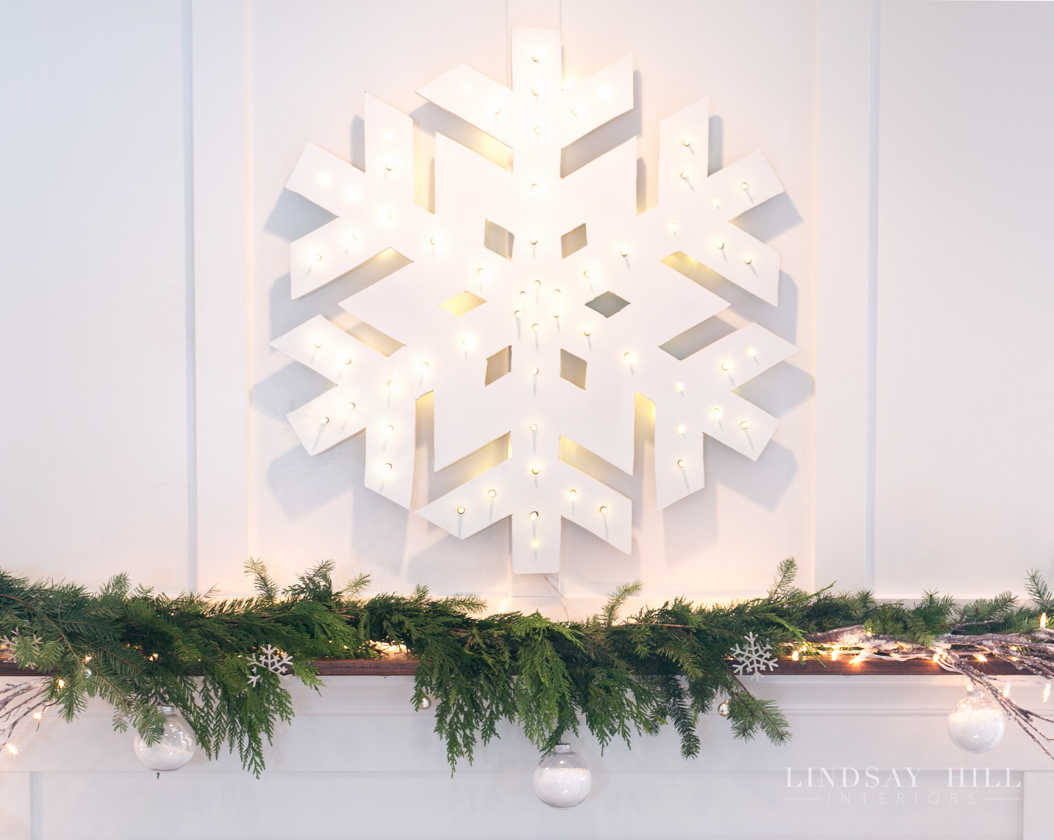 lindsay hill interiors holiday living room mantle snowflake