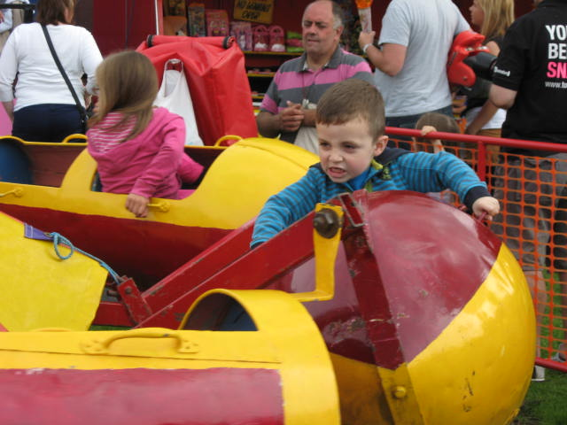Small child enjoying a fairground rocket ride