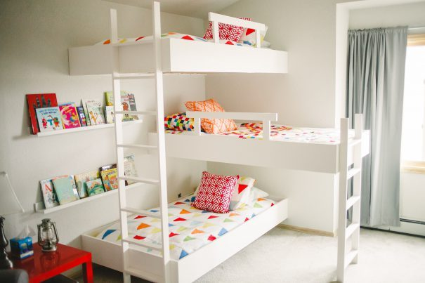 Three white bunk beds for children