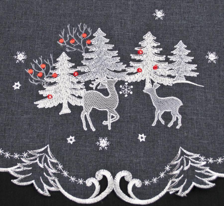 round doilies with embroidered silver reindeer