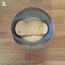 Soak the slices of bread in the bowl and let it rest for a bit so that it can absorb the egg and milk mixture.