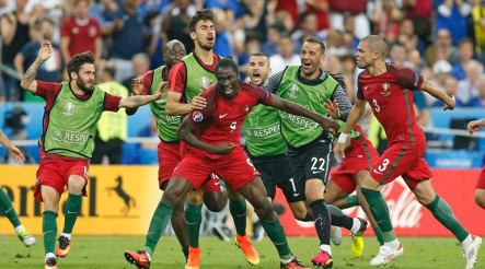 Portugal's Eder, centre, celebrates after scoring the opening goal during the Euro 2016 final soccer match between Portugal and France at the Stade de France in Saint-Denis, north of Paris, Sunday, July 10, 2016. (AP Photo/Michael Probst)