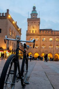 Piazza Maggiore, Bologna, Italy. Picture of a bike in Piazza Maggiore. It is evening and the square is enlighted