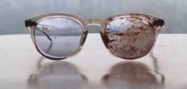 occhiali sporchi del sangue di John Lennon