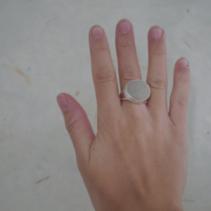 beach stone ring on a hand