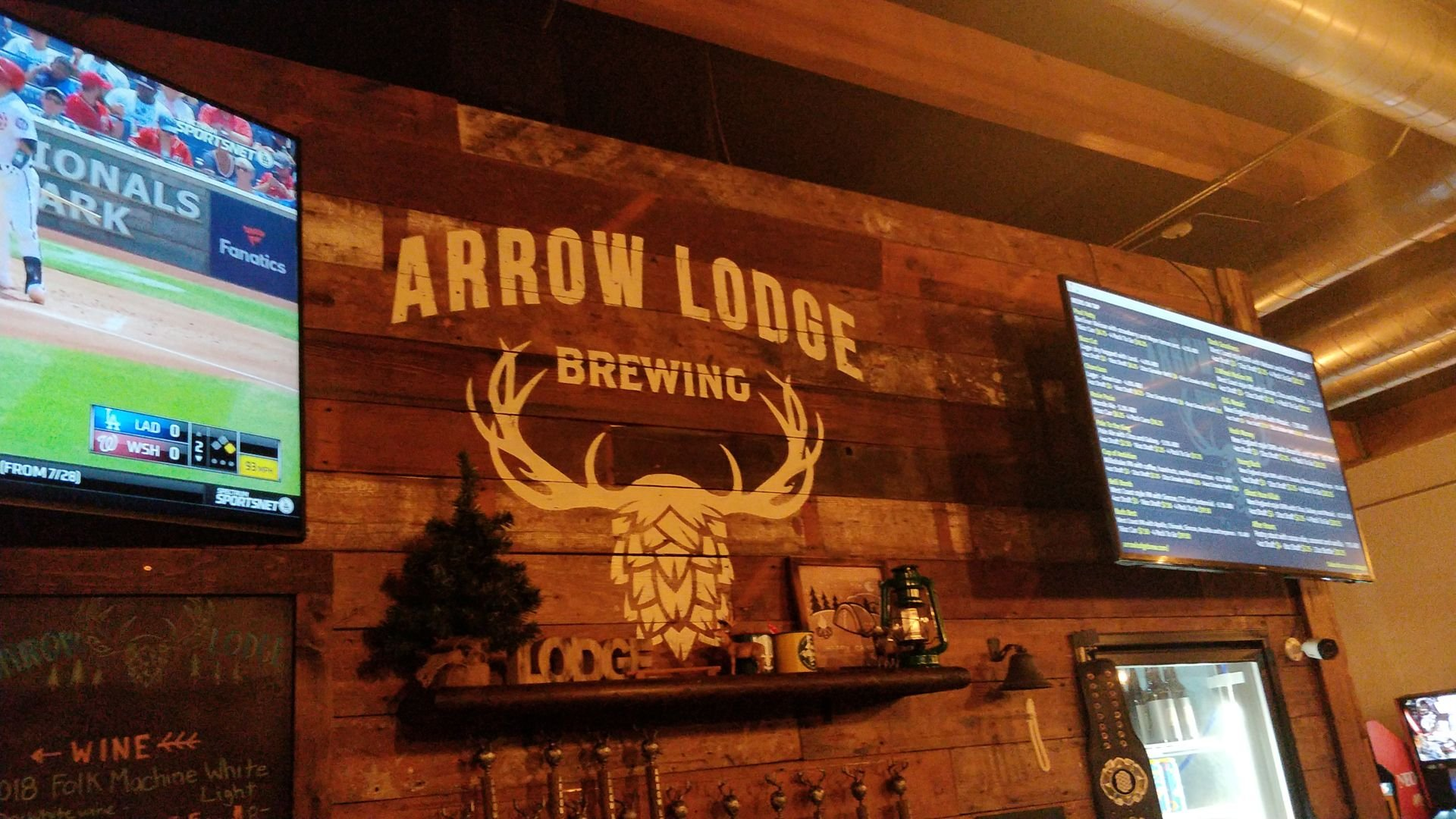 Arrow Lodge logo at the bar