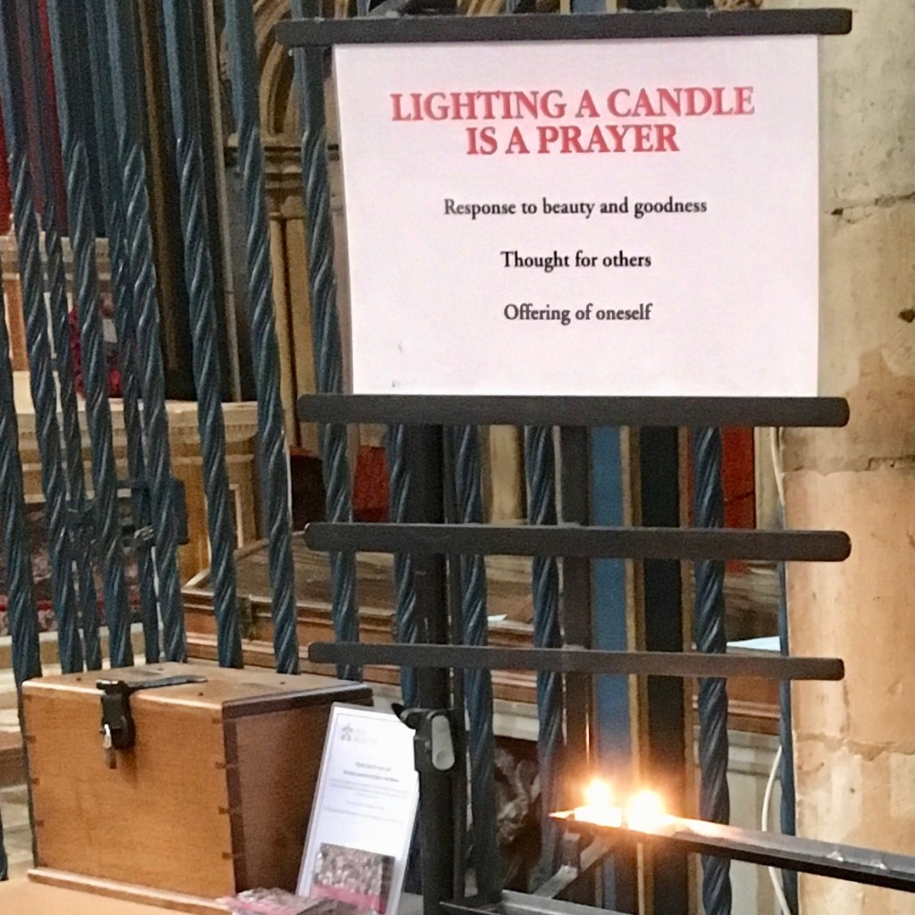 """Lighting a Candle Is A Prayer"", sign in York Minster, England."