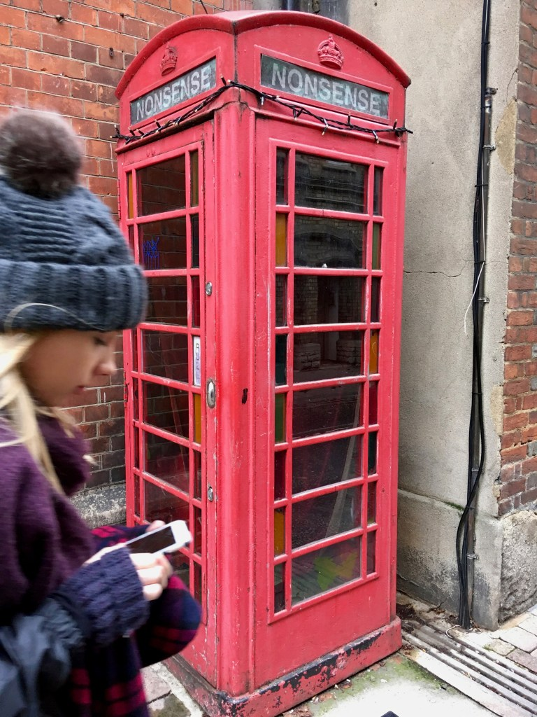 Walking past a telephone booth in Oxford