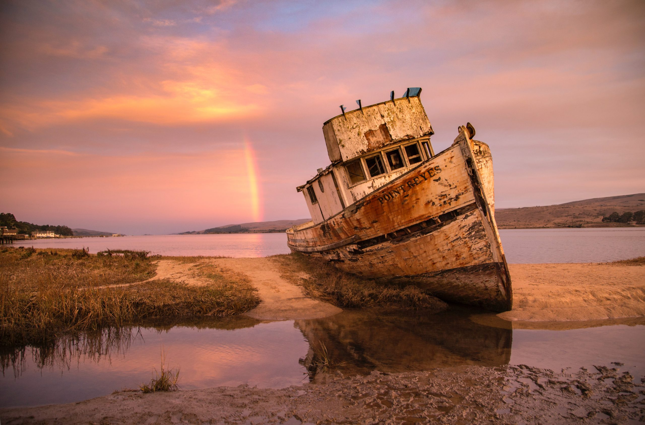 Shipwreck with rainbow in background