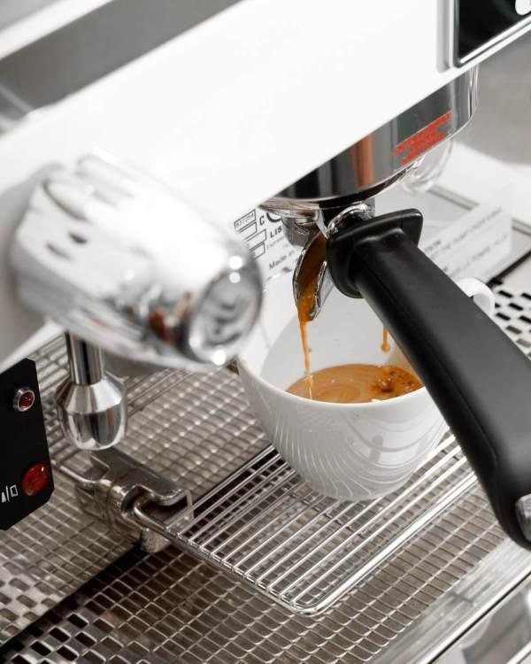 espresso shot white cup espresso machine astoria pulling espresso