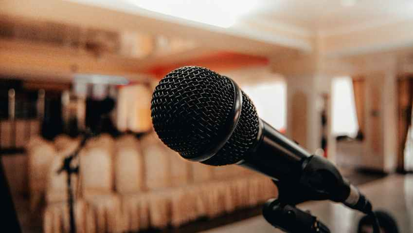 black microphone in light conference hall