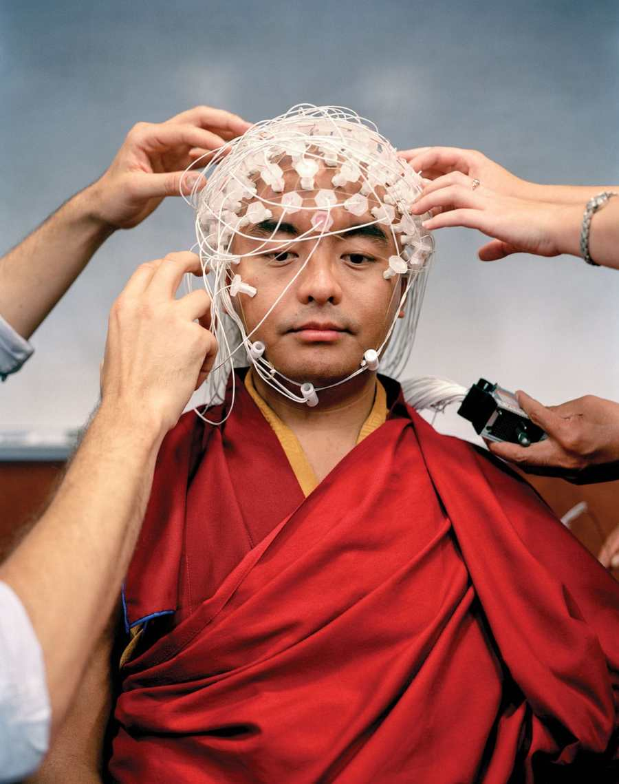 Yongey Mingyur Rinpoche is fitted with 256 thin wires to measure his brain waves while he meditates.