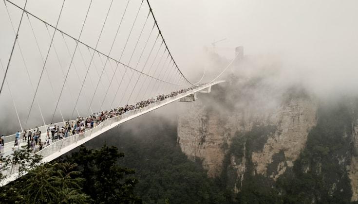 Glass footbridge over a canyon.