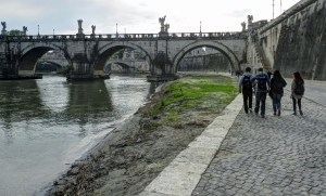 At most every bridge in Rome steps lead down to the Tiber River.