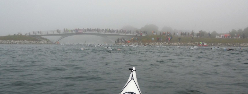 The view from my kayak as swimmers head under the footbridge. Fog rolled in Sunday morning but it didn't interfere with the race.