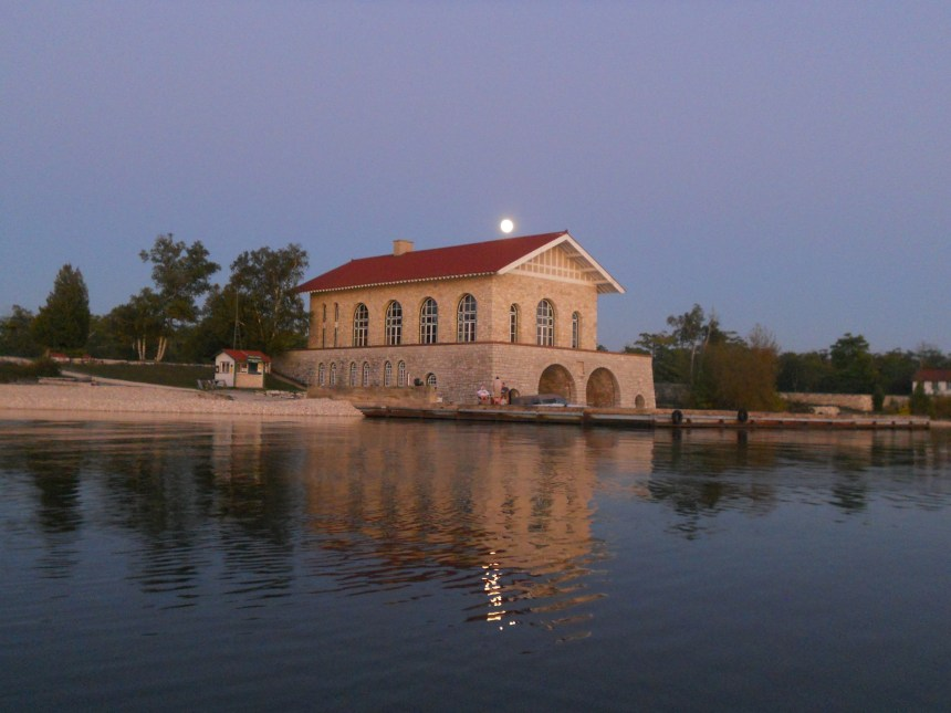 Moon rising over the boat house.