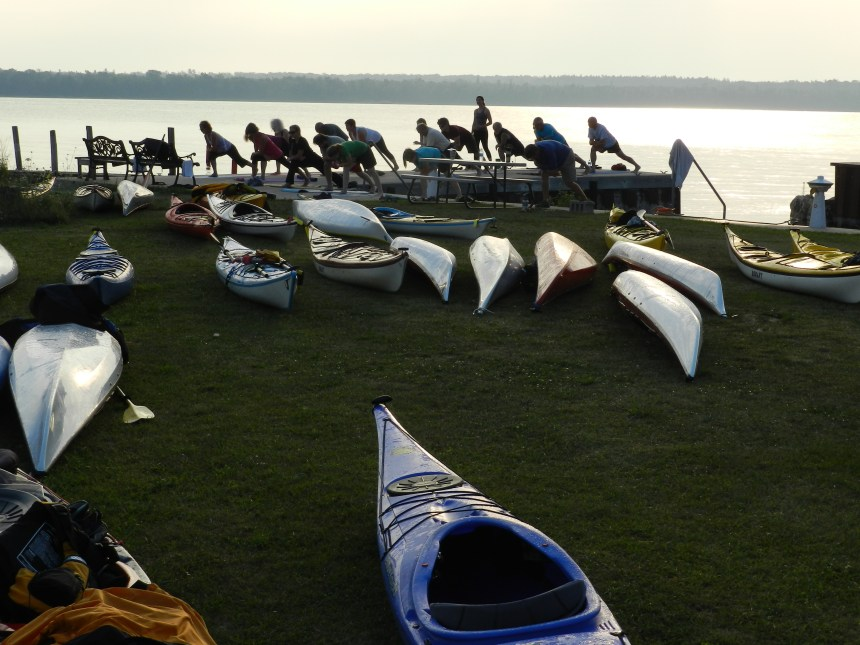 Participants at the 2012 DCSKS try a sunrise yoga session.
