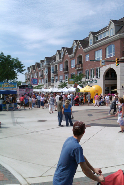 View of Art in the Park on Main Street with vendors and attendees