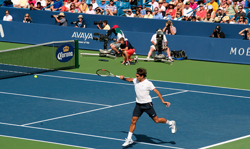 Roger Federer lands a backhand in his match