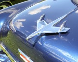 Hood ornament on blue Chevrolet Bel Air