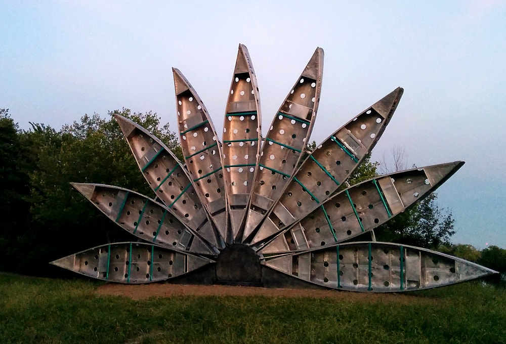 Canoe Fan sculpture - a half-circle of fans forming an upright sculpture