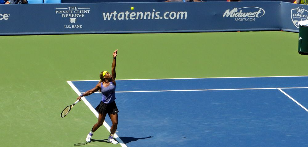 Serena Williams serves on Center Court at Western and Southern Open in Cincinnati, Ohio