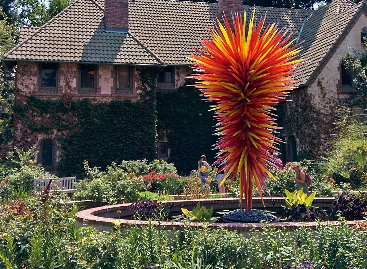spires of red, orange, and yellow glass rods rise from the center of the garden